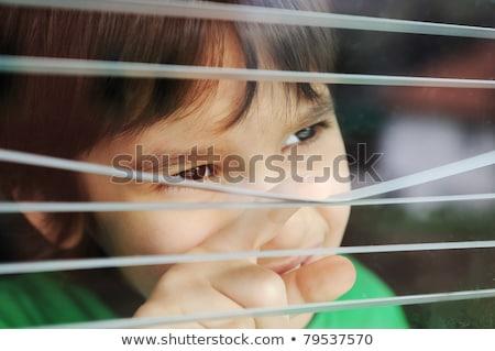 Portret onschuldige klein jongen venster achtergrond Stockfoto © zurijeta