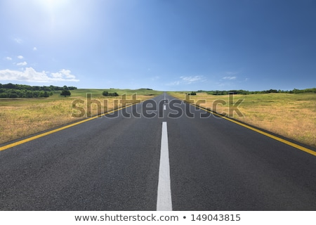 Stock photo: Straight Line Highway in the Country on a Clear Sunny Day