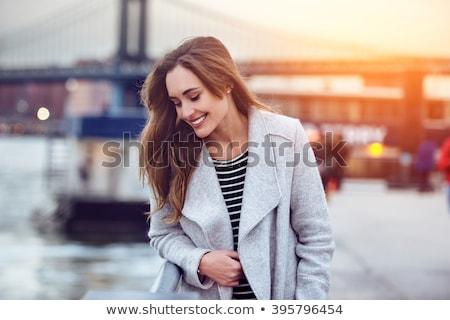 Femme manteau lumineuses photos modèle automne Photo stock © dolgachov