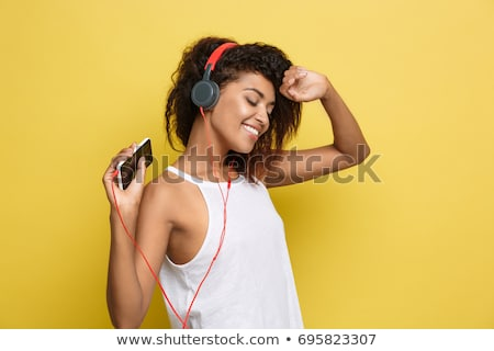 Mooie zwarte vrouw hoofdtelefoon mooie glimlachend afro-amerikaanse Stockfoto © Edbockstock