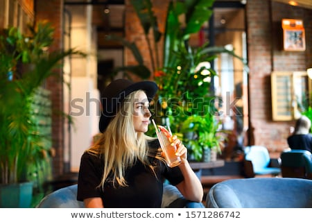 Cute girl with cocktail glass Stock photo © glyph
