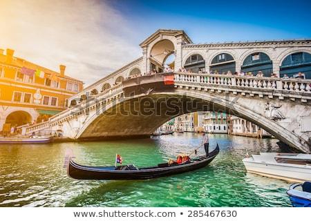 Veneziano gôndola ponte silhueta laranja cidade Foto stock © mayboro