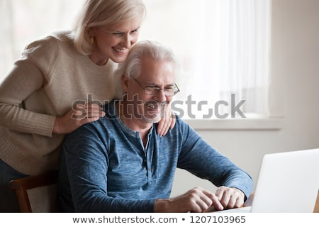 a couple laughing behind a computer stock photo © photography33