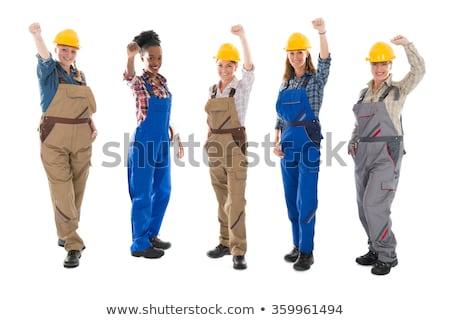 Stockfoto: Female Builder Raising Fist