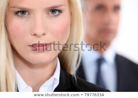 Pretty blonde woman in a suit with an older man out of focus in the background Stock photo © photography33