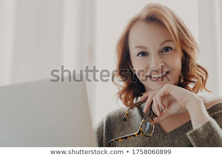 Foxy businesswoman using a laptop computer Stock photo © photography33