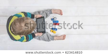 Stok fotoğraf: Little Boy Watching A Toy Car