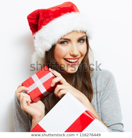 beautiful brunette in santa hat with gift stock photo © stryjek