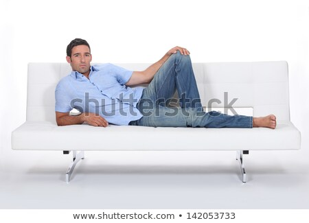 Sulky man lying on a couch Stock photo © photography33