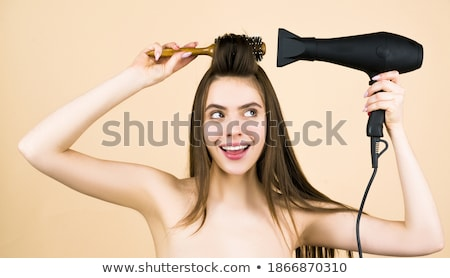 Brunette with hairdryer Stock photo © photography33