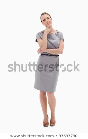 thoughtful businesswoman posing against white background stock photo © wavebreak_media