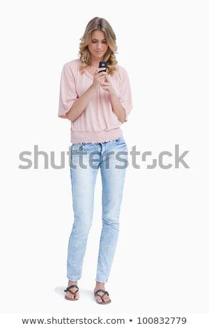 nő · áll · felfelé · tart · mobiltelefon · fehér - stock fotó © wavebreak_media
