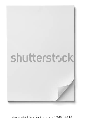close up of stack of papers with curl on white background Stock photo © Zhukow