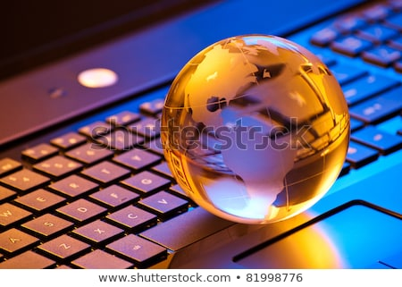 Stock photo: Blue glass globe on keyboard