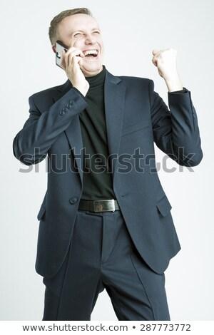 молодые привлекательный счастливым улыбка деловой человек стоять Сток-фото © dacasdo