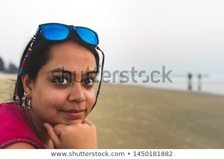 Stare. Summer portrait of beautiful woman face at sunset, ocean  Stock photo © Victoria_Andreas