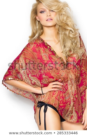 Beautiful blonde girl fashion wind long hair over white Stock photo © lunamarina