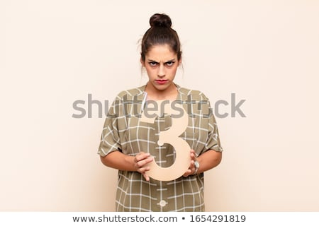 Portrait of girl holding number 3 Stock photo © zzve