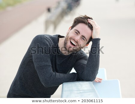 casual man with hand in hair stock photo © feedough
