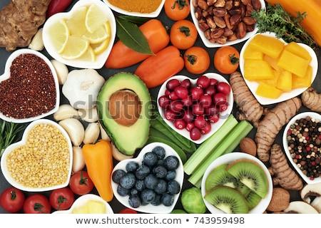 Salud alimentos hermosa jóvenes morena mujer Foto stock © lithian