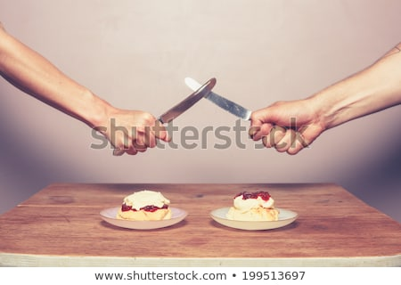 two scones with clotted cream and jam stock photo © sumners