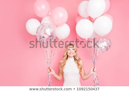 blonde woman holding ballons stock photo © chesterf