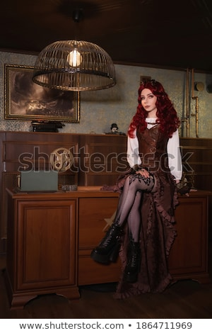 attractive steam punk girl sitting stock photo © nejron