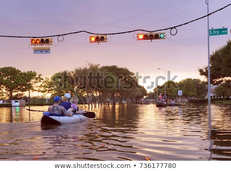 sunset in the flooded city stock photo © kayco