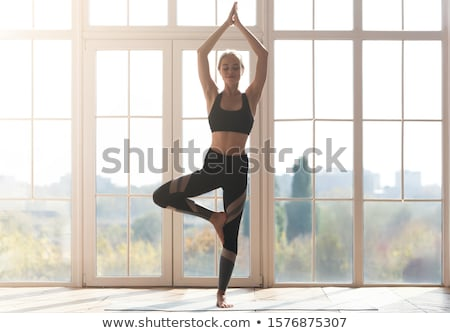 woman doing stretching yoga exercises stock photo © hasloo