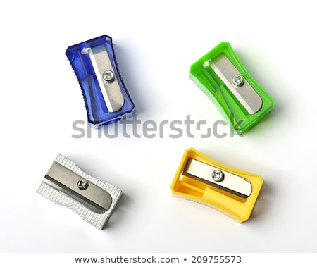Red color metal pencil sharpener isolated  Stock photo © hin255