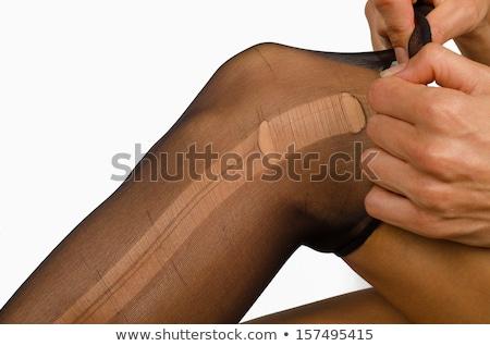 Feminino pernas rasgado meia-calça branco isolado Foto stock © Nobilior
