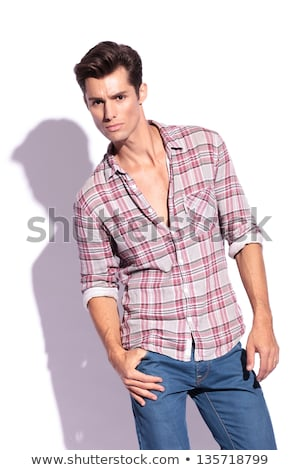 young fashion man holding his thumbs in pockets Stock photo © feedough