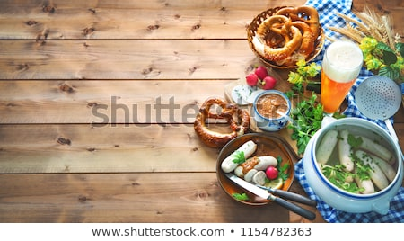 bavarian veal sausages on a plate with sweet mustard and pretzel stock photo © Rob_Stark