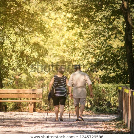 Middle aged man walking with two crutches Stock photo © stockyimages