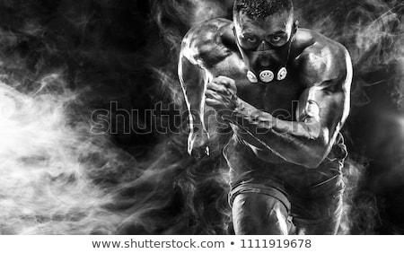 Forte homem imagem sem camisa brasão peito Foto stock © pressmaster