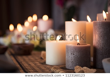 romantic spa candles burning stock photo © stevanovicigor