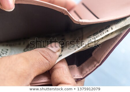 Woman holding Indian paper currency and a credit card Stock photo © imagedb