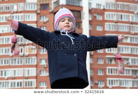 little girl with divorced hands against background building Stock photo © Paha_L