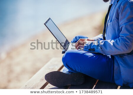 Businessman sitting  on the meadow with hands up Stock photo © Paha_L