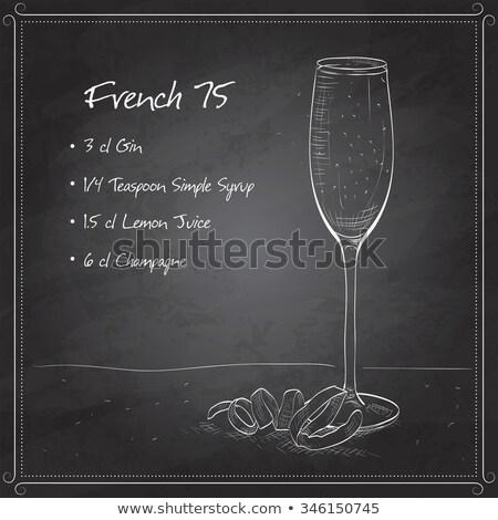 Cocktail French 75 on black board Stock photo © netkov1