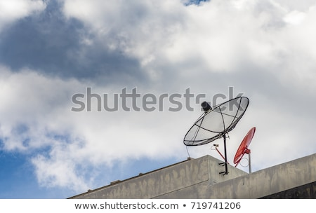 Antennas and a satellite dish on a roof Stock photo © lightpoet