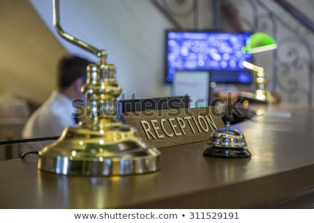 Hotel service call bell on wooden reception front desk Stock photo © stevanovicigor