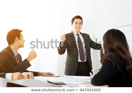 Businessman cheering with clenched fist Stock photo © wavebreak_media