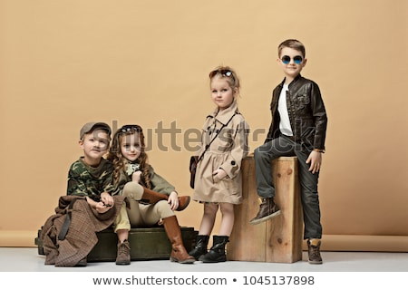 fashionable girl in leather posing in studio background  Stock photo © feedough