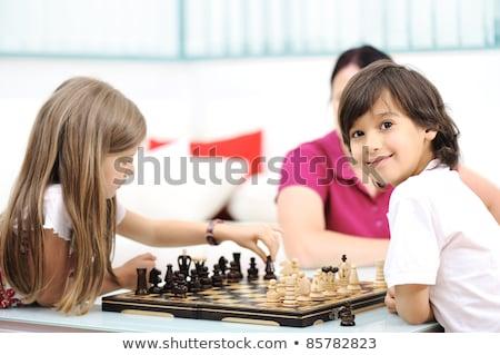jóvenes · familia · jugando · ajedrez · año · edad - foto stock © zurijeta