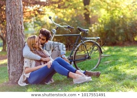 Happy young couple embrace in park Stock photo © artfotodima