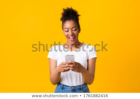 Happy young lady with telephone Stock photo © stockfrank