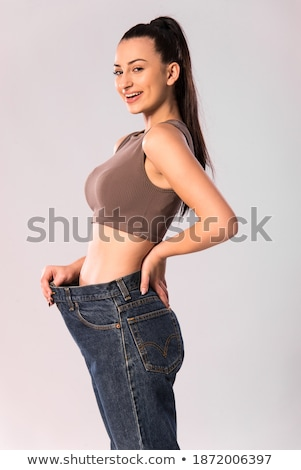 Belly of beautiful and slim young caucasian lady Stock photo © Nobilior