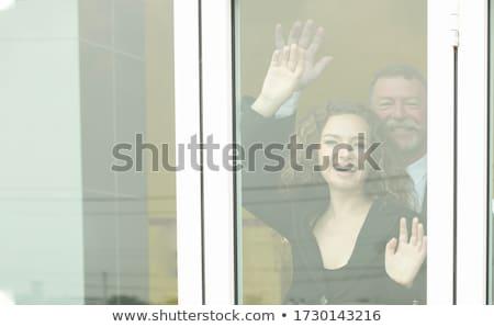 Portret jonge man naar achter venster jonge Stockfoto © konradbak