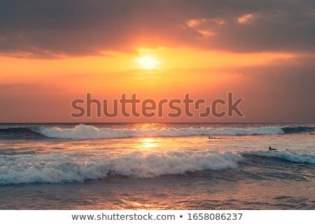 Surfista azul mar laranja céu windsurf Foto stock © Mikko